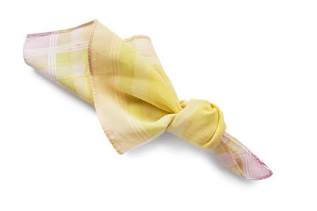 knotted: Yellow cotton handkerchief knotted isolated over white