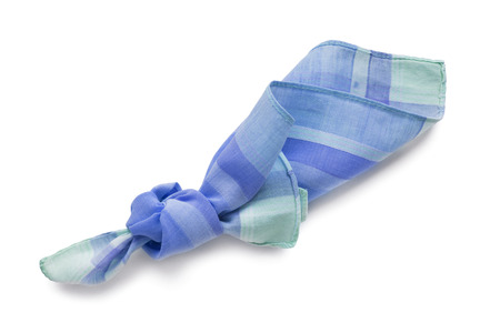 Knotted blue cotton handkerchief on white background photo