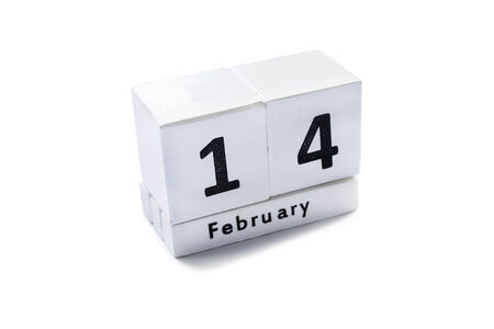 Desk calendar with a date february foruteenth isolated over white photo