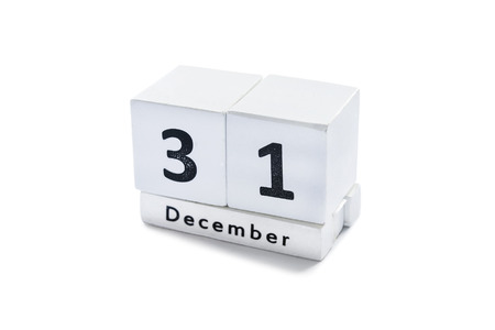 Desk calendar with a date december 31 on white background photo