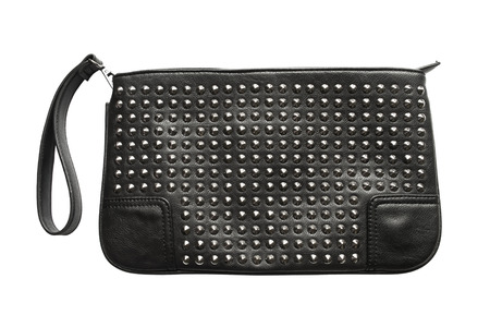 Black leather handbag with metal rivets isolated over white photo