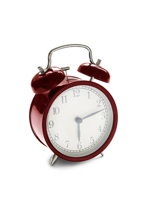 Red metal vintage alarm clock isolated over white photo