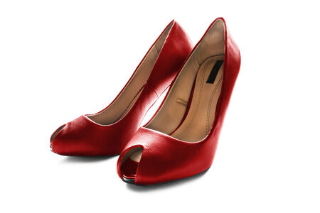 Pair of bright red leather high heeled shoes isolated over white photo