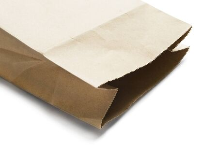 opened bag: Part of opened brown kraft paper bag on white background