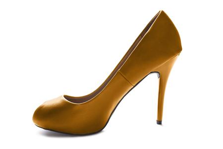 high heeled shoe: Golden stylish leather high heeled shoe on white background Stock Photo