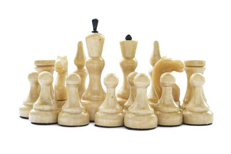 Group of white chess pieces isolated over white photo
