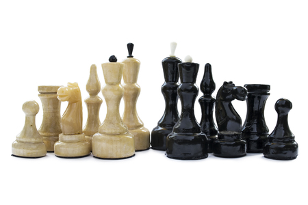 Group of black and white chess pieces on white background photo