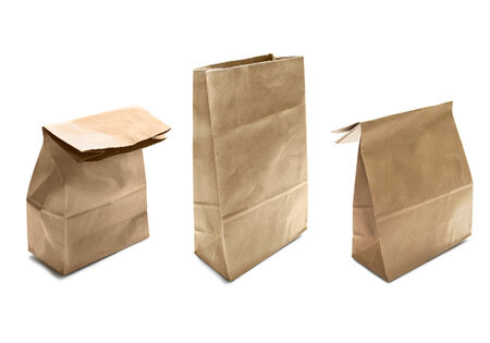 Group of three brouwn craft paper bags on white background photo