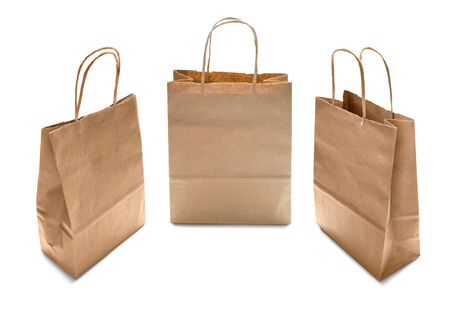 Set of three kraft paper brown bags on white background photo