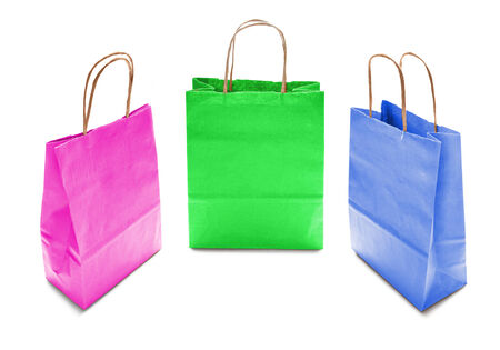 Set of three colorful kraft paper bags on white background photo