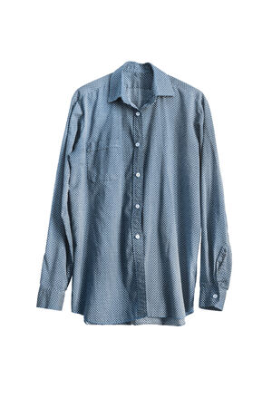 buttoned: Blue buttoned male shirt with white dots isolated over white Stock Photo