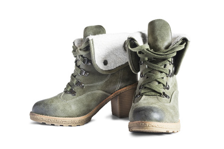 Pair of khaki leather heeled boots isolated over white photo