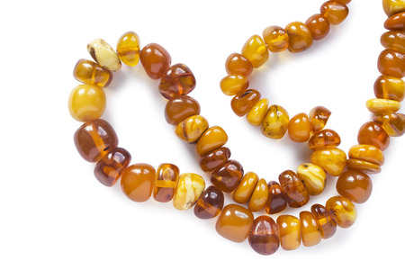 String of amber beads isolated over white