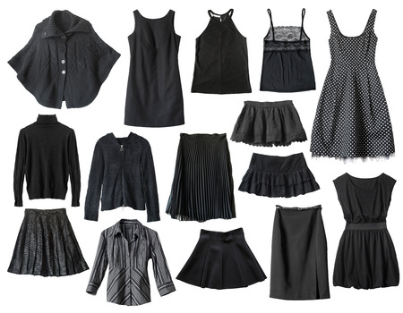 Set of black female clothes isolated over white