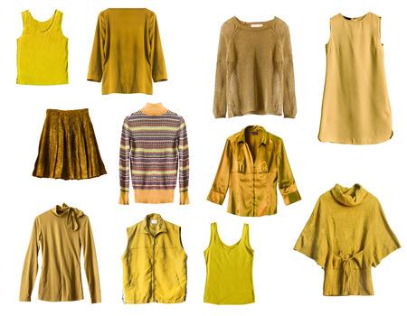 白い背景の上に黄色の女性服を設定します。