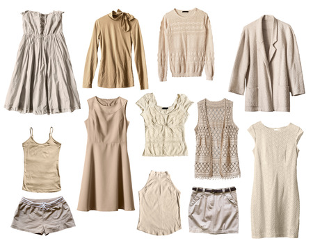Set of beige female clothes isolated over white