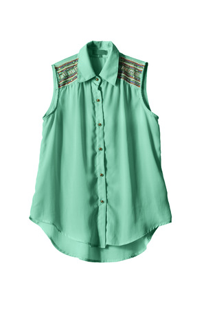 Sleeveless cyan buttoned blouse decorated with crystals isolated over white