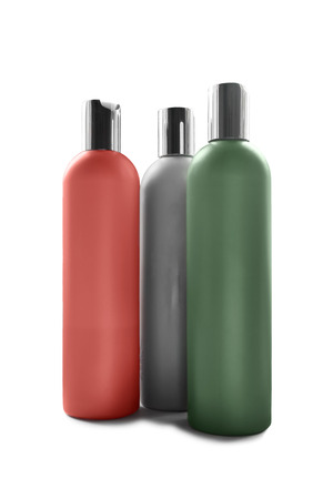 Group of three cosmetic blank plastic bottles on white background photo