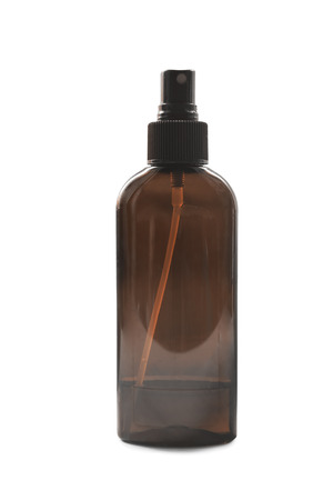 Brown transparent spray bottle on white background