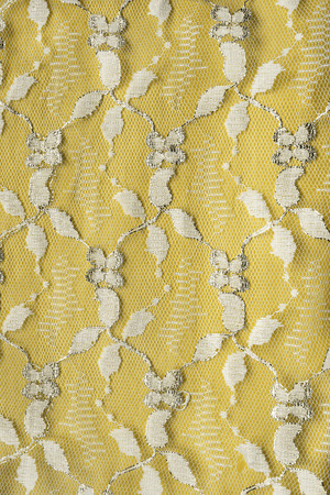 Golden lace with metal thread closeup as a background photo