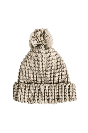 pompon: Beige knitted wool cap with pompon on white background