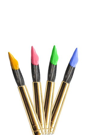 Group of four paint brushes isolated over white photo