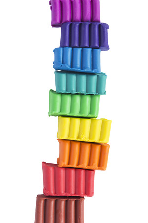 Pieces of colorful plasticine isolated over white photo
