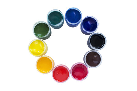 Jars of multicolor paint isolated over white photo
