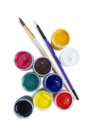 Grou of two paint brushes and some gouache jars isolated over white photo