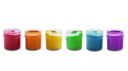 Set of multicolor gouache paint jars on white background photo
