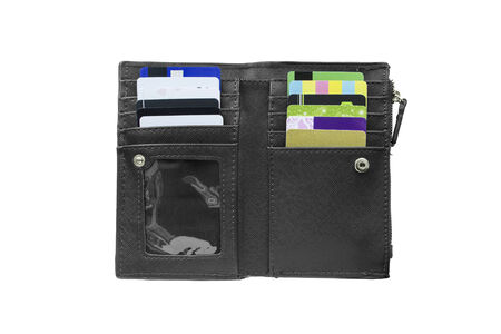 Black wallet with some credit cards on white background photo