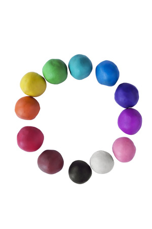 Circle of multicolor plasticine balls on white background photo