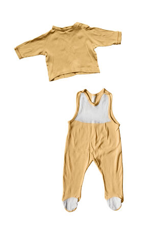 Set of yellow baby bodysuit and shirt on white background photo