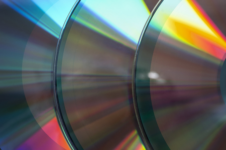 Laser compact discs closeup as a background