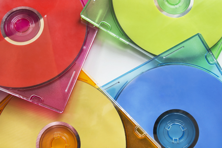 Group of colorful compact disks in boxes as a background photo