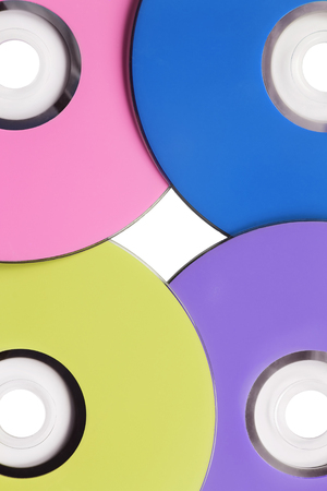 Four blank compact disks closeup as a background