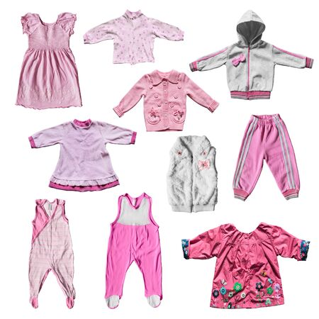 girlish: Set of pink girlish clothes isolated over white