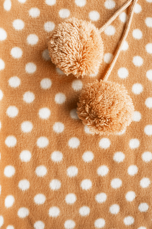 terry: Pompoms on yellow fleece cloth as a background