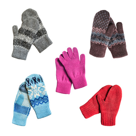 Set of knitted wool mittens and gloves on white background photo
