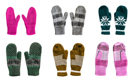 Group of warm knitted mittens isolated over white photo