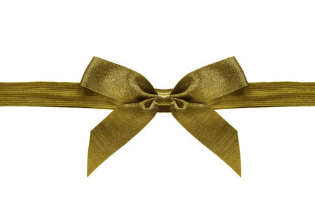 Golden silk bow on a ribbon isolated over white photo