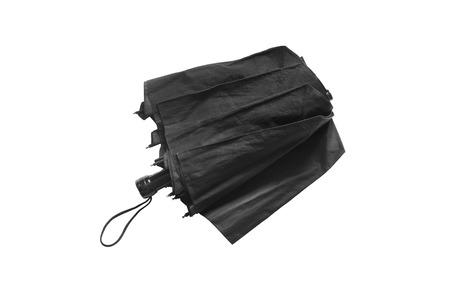 白い背景の上の折りたたみ傘ブラック