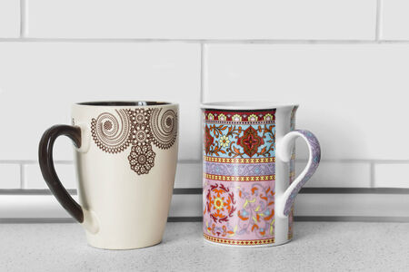 housewares: Two ceramic mugs on a desk as a background