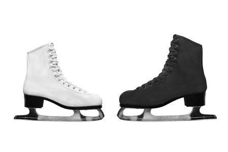 figure skating: Male and female figure skating boots on white background Stock Photo