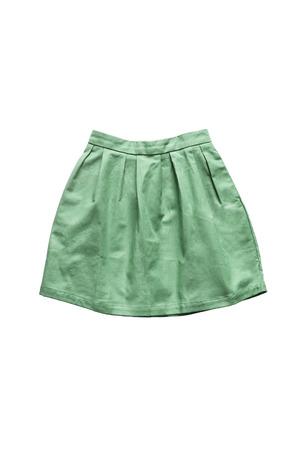 Green mini skirt on white background Imagens