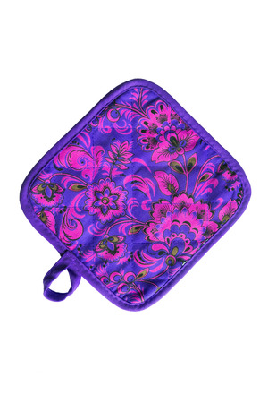 Purple ornamental quilted potholder isolated over white photo