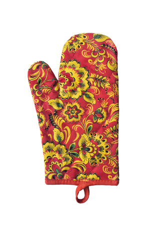 Ornamental quilted oven-glove on white background photo