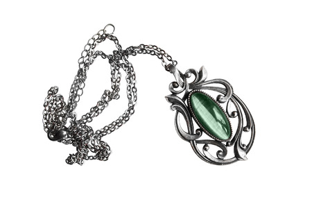 nephritis: Vintage silver pendant with green gemstone isolated over white