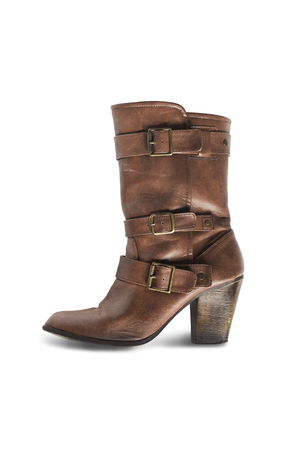 walk in closet: Brown leather western boot on white background