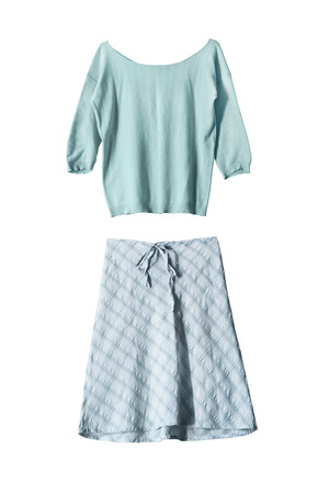Set of light blue elegant skirt and knitted pullover on white background photo